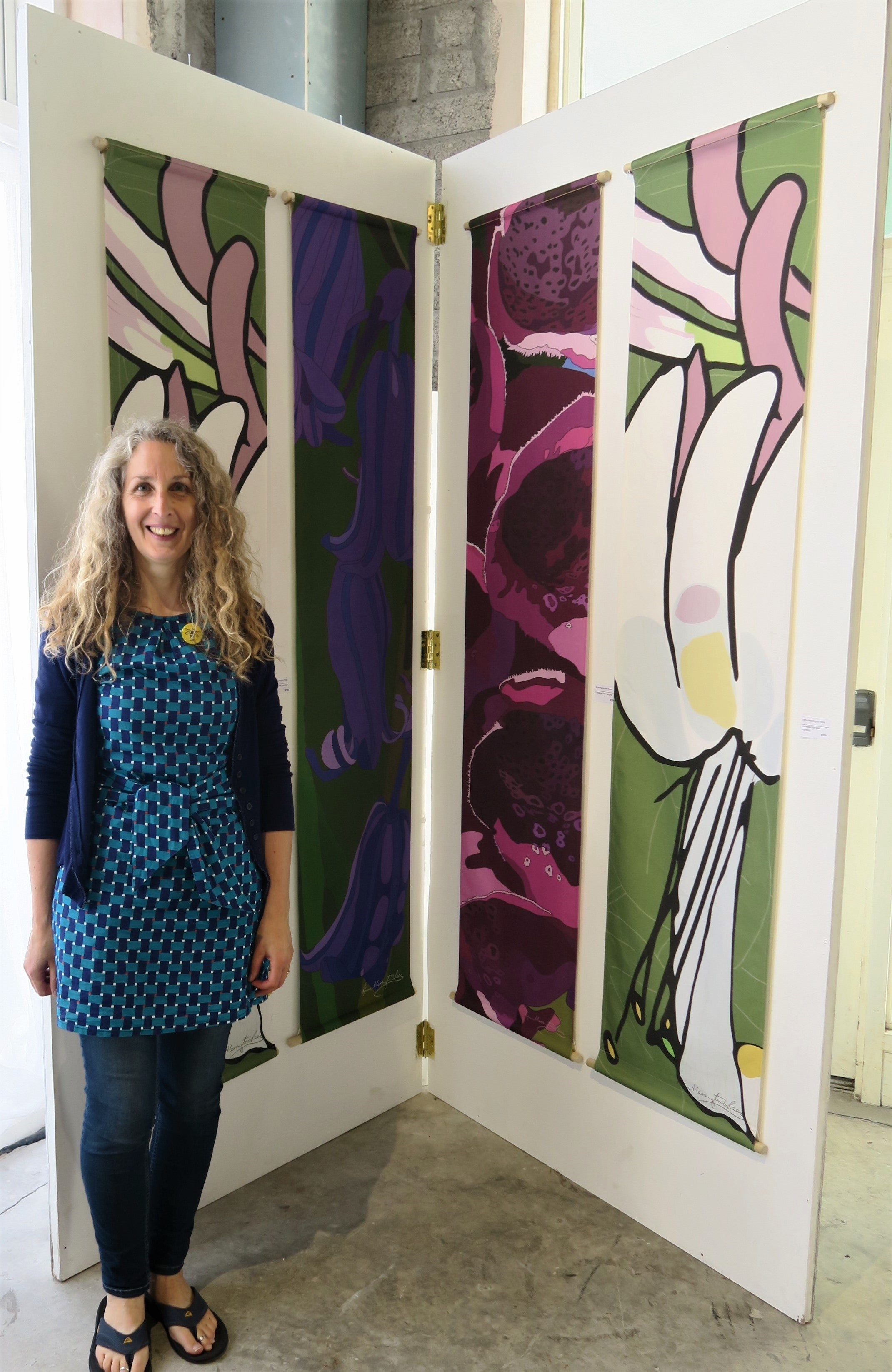 Anne Harrington Rees in front of Honeysuckle, Bluebell and Foxglove wall hangings at the opening of West Cork Creates 'Into the Woods', Skibbereen, August 2019
