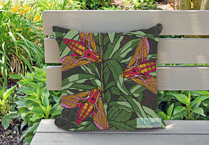 Colourful gift – Green, Pink, Mustard, Yellow, White and Brown Willowherb Moths design cushion on garden bench.