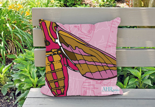 Colourful gift – Pink, Mustard, Yellow, White and Brown Elephant Hawk Moth design cushion on garden bench.