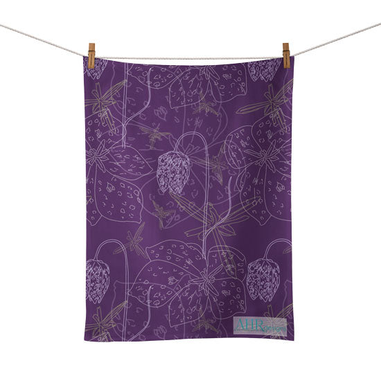 Colourful gift – Purple, White and Yellow Fritillaria flower design tea towel hanging from clothesline, white background.