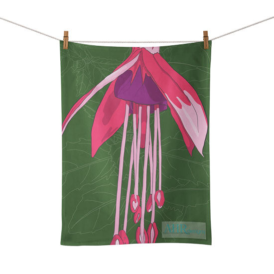 Colourful gift – Pink, Purple and Green Fuchsia flower design tea towel hanging from clothesline, white background.