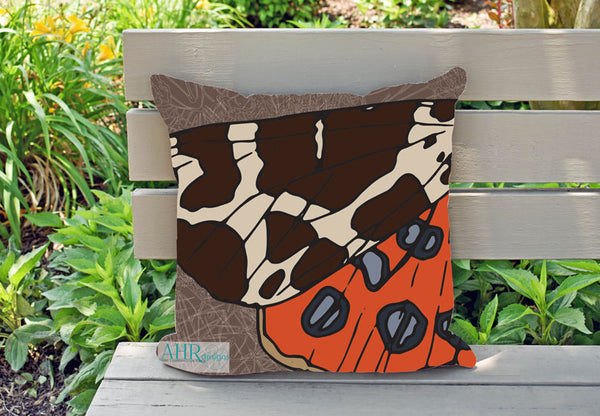 Colourful gift – Brown, Orange, Cream and Blue Garden Tiger Moth design cushion on garden bench.