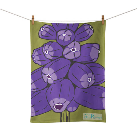Colourful gift – Purple and Green Muscari flower design tea towel hanging from clothesline, white background.