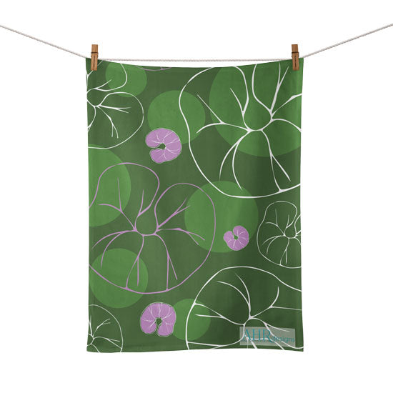 Colourful gift – Green, Pink and White Sea Bindweed flower design tea towel hanging from clothesline, white background.