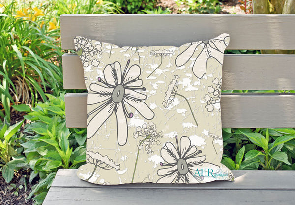 Colourful gift – Cream, Pink, Green and Grey Wild Carrot flower design cushion on garden bench.