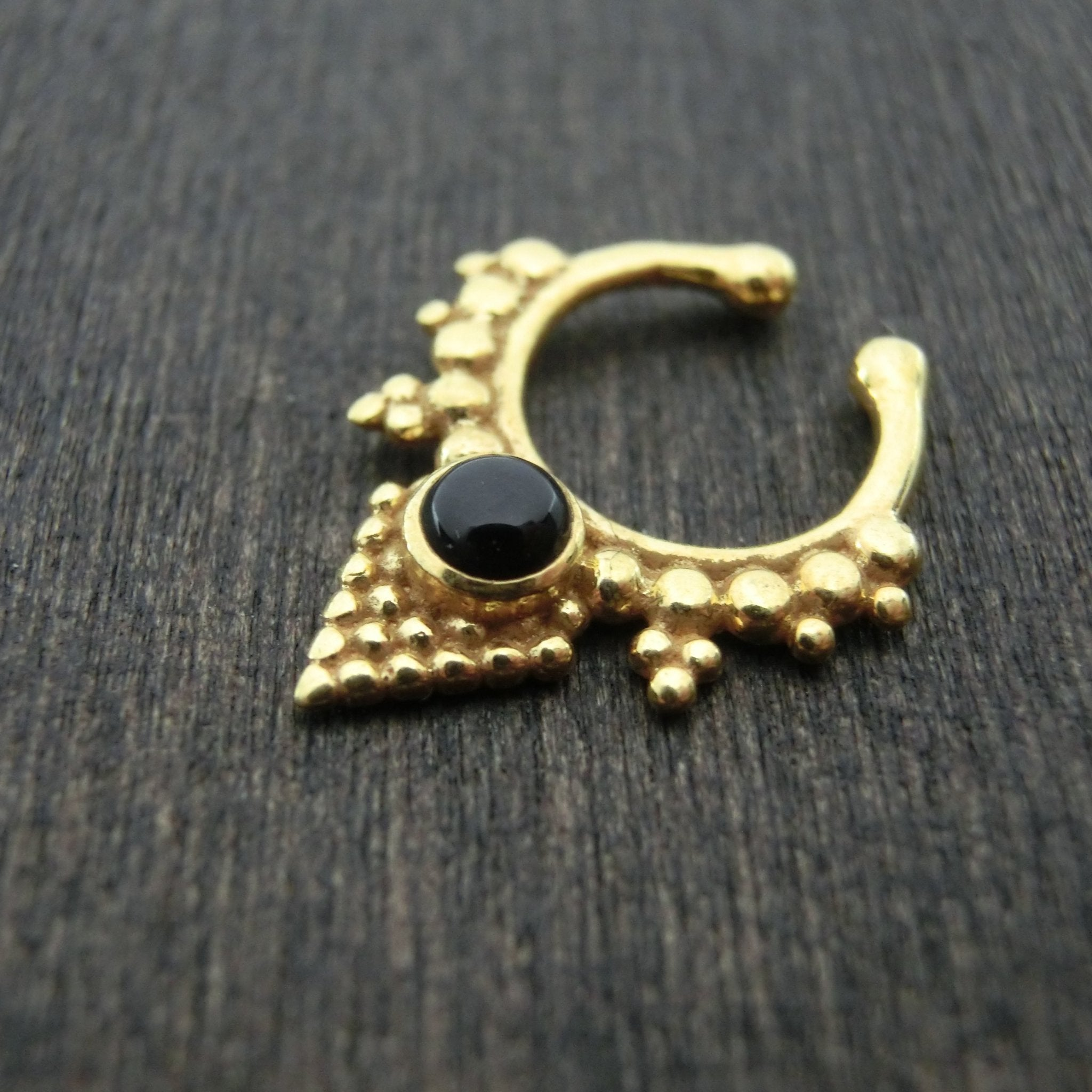 gold fake septum with black onyx