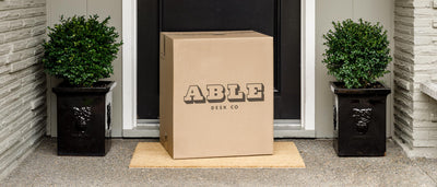 Able Desk Co Package on a Home Door Step