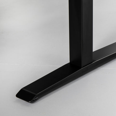 Close up of a black desk frame foot component