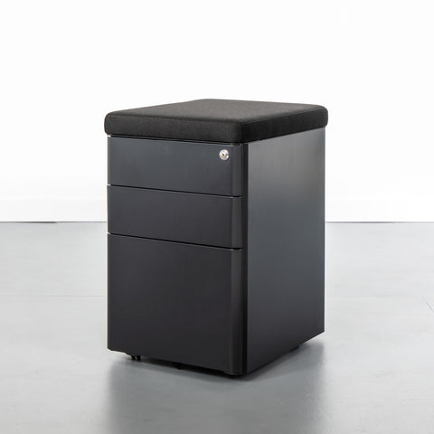 Black office storage cabinet with 3 drawers and a black magnetic cushion top