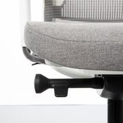 White office chair grey seating cushion and multifunctional lever