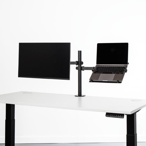 Black monitor desk mount with laptop attachment