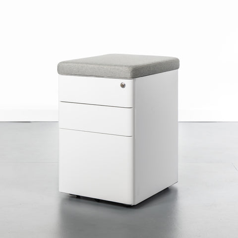 White office storage cabinet with 3 drawers and a grey magnetic cushion top