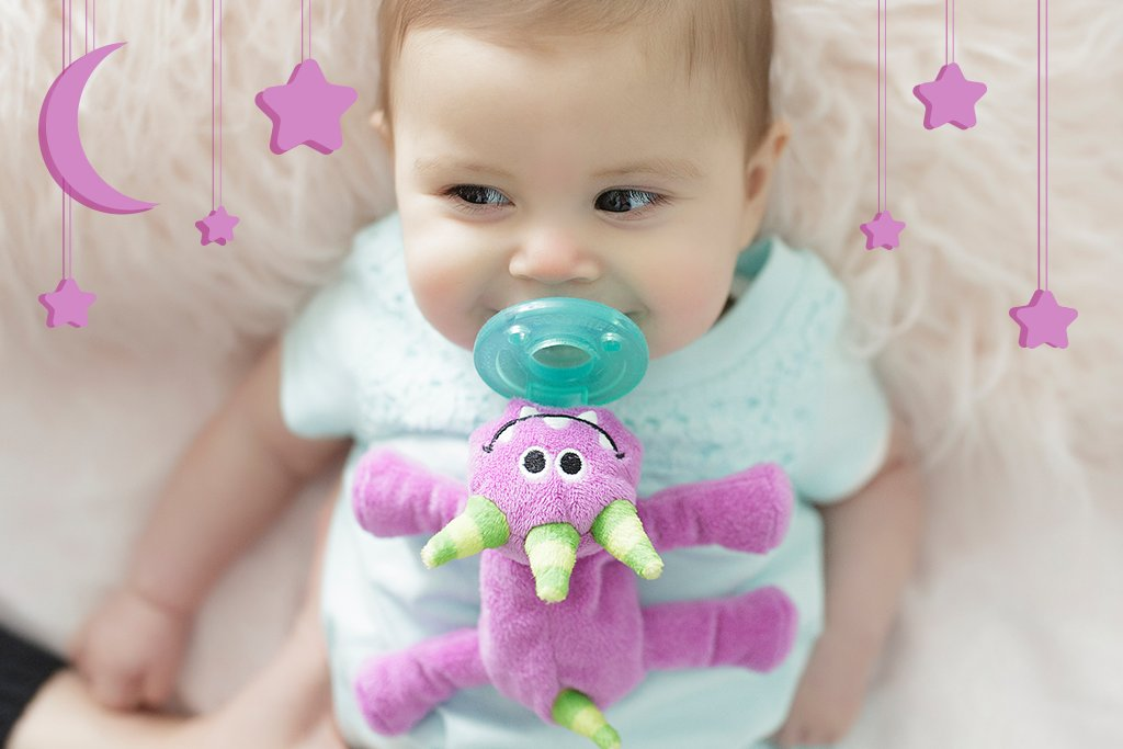 Storybook Friends Collection Image is a baby with purple monster and purple stars and moon decor