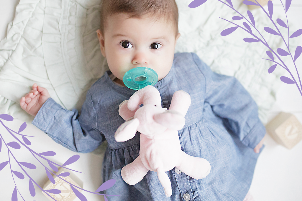 Nursery Tones Collection image has a baby with a pink elephant