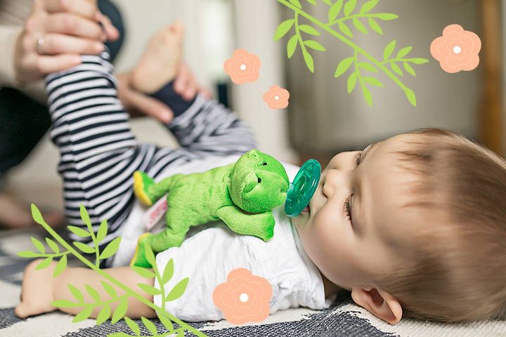 Spring collection image has a baby with the bright green frog with yellow accents