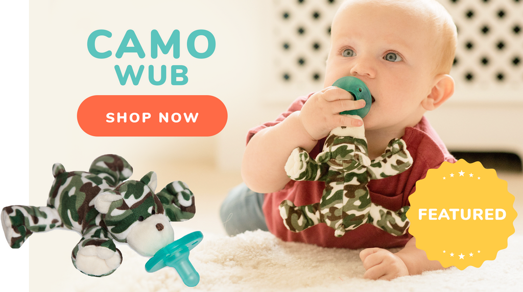 image of baby with green camouflage wubbanub pacifier