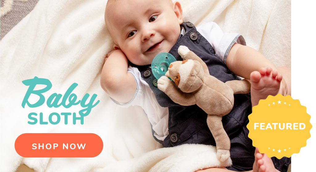 featured image of baby with sloth wubbanub that is tan with brown and cream accents around face