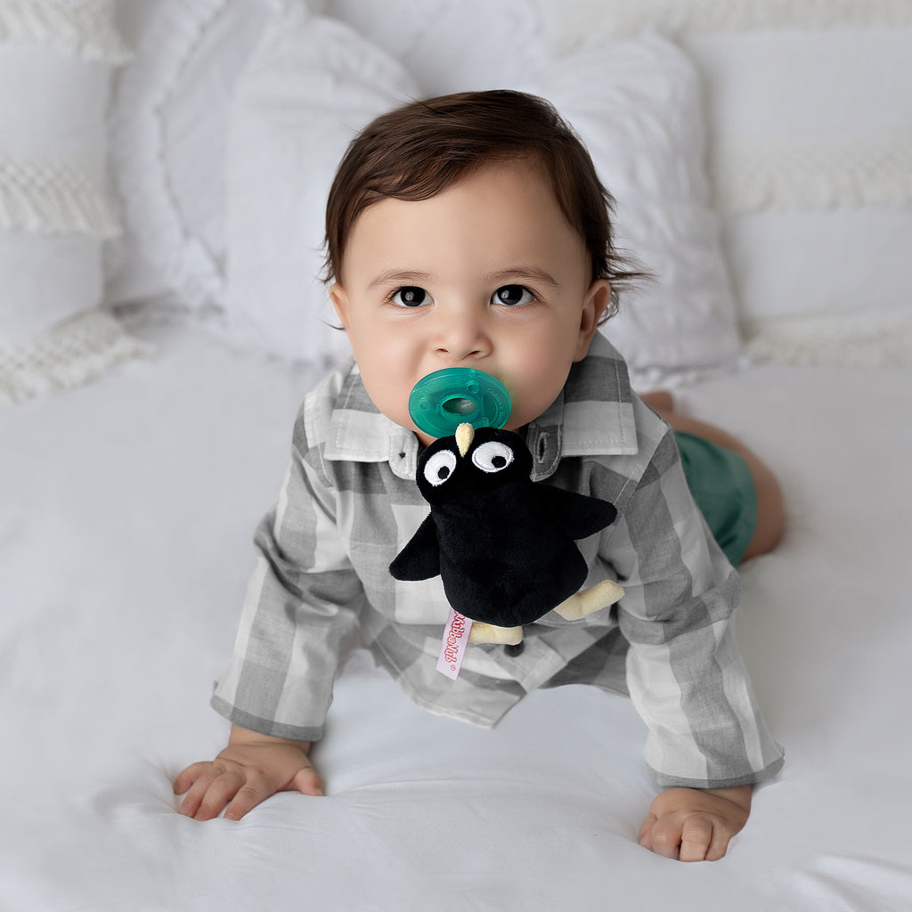 Lifestyle photo of Baby with Jimmy Fallon MAMA Penguin WubbaNub
