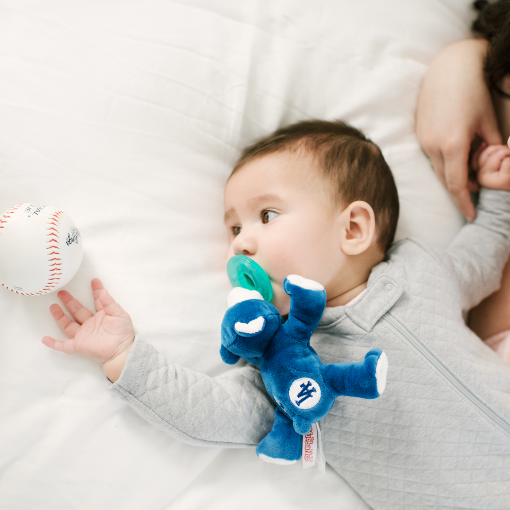 lifestyle photo of baby with LA Dodgers WubbaNub
