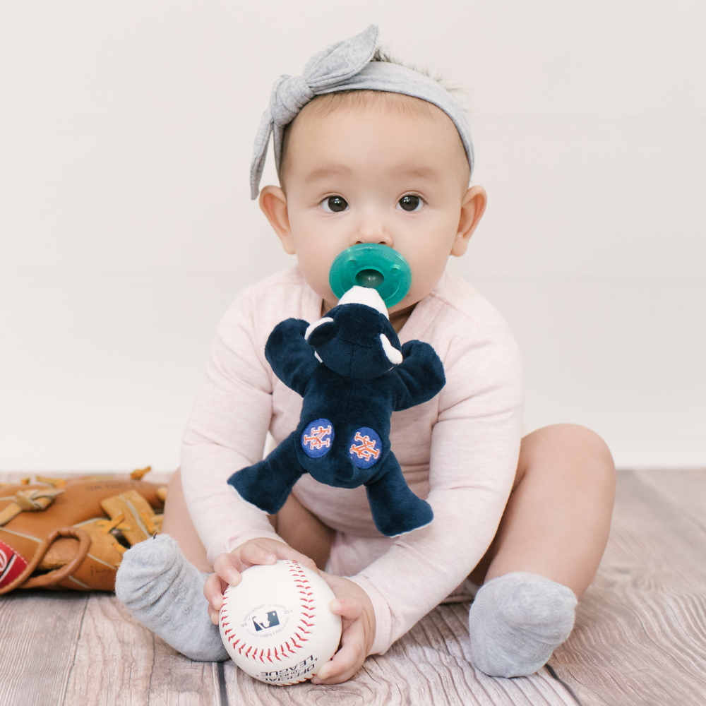 Baby using NY Mets WubbaNub