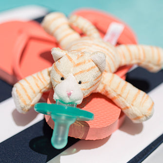 WubbaNub Infant Pacifier Tan and cream striped tabby kitten has white accents and a pink nose