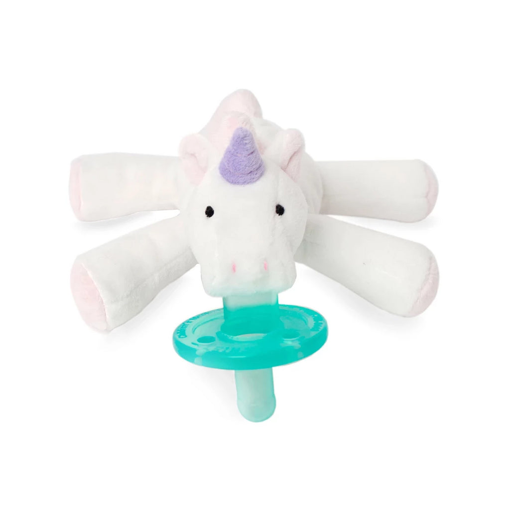WubbaNub Unicorn is white with purple horn and pink accents