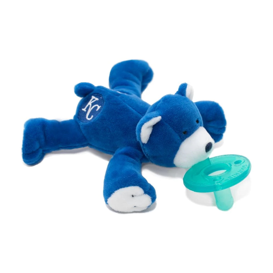 WubbaNub MLB Kansas City Royals plush pacifier is soft royal blue fabric with white accents on paws, ears and face and KC symbol on rear