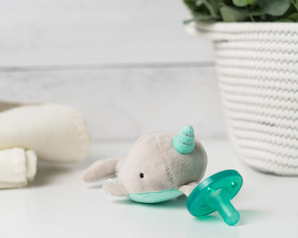 Marni Narwhal is grey with a teal belly and matching horn highlighted with shimmering pink.  Sea Unicorn
