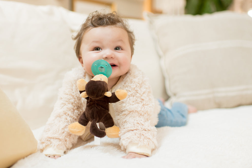 baby with wubbanub brown monkey
