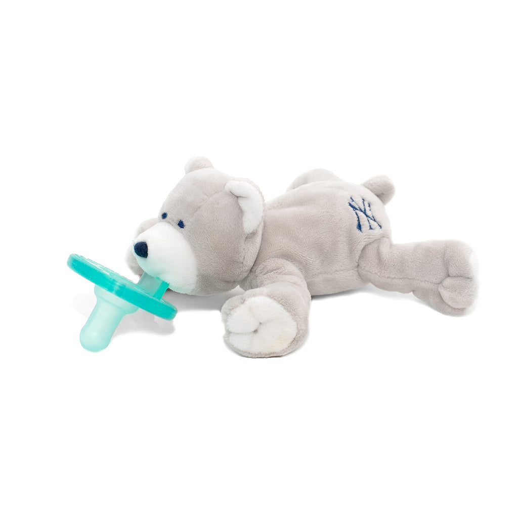 WubbaNub MLB New York Yankees Bear pacifier is light grey with accents of white on pads, face and ears and has the NY Yankees emblem on rear