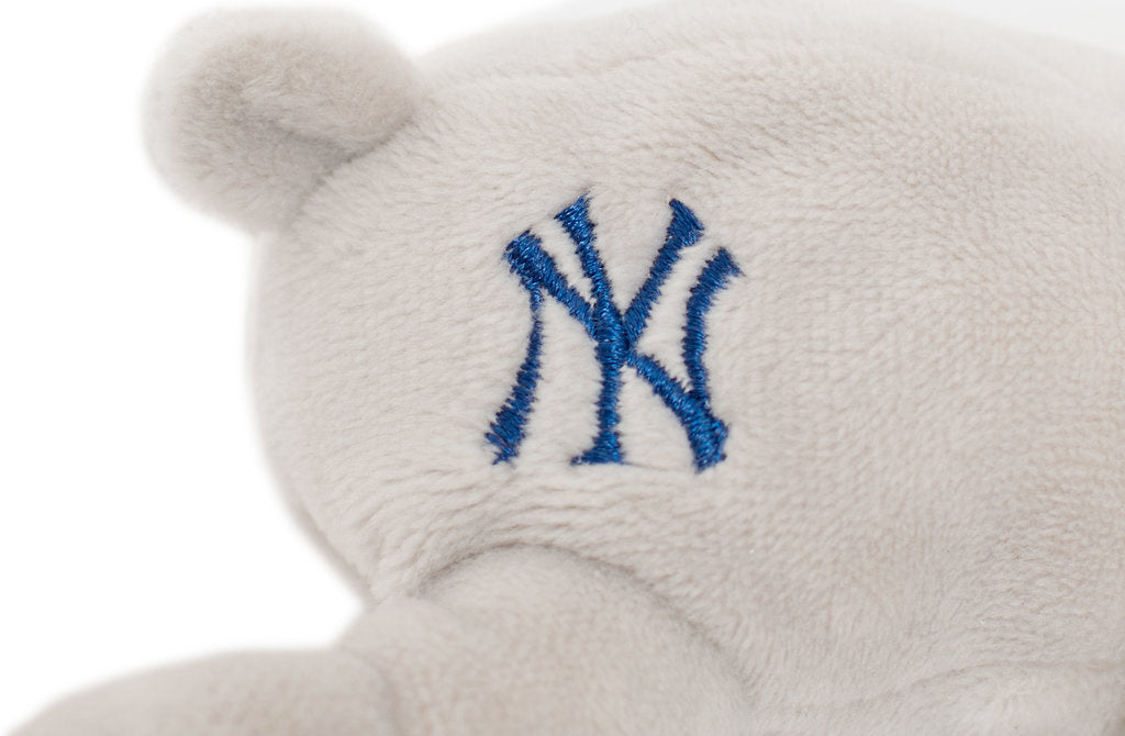 New York Yankees emblem embroidered in blue stitching on grey fabric
