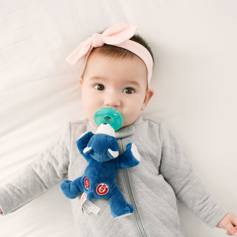 WubbaNub MLB Chicago Cubs Bear is royal blue with embroidered red cubs stitching.  Lifestyle photo with baby and cubby bear