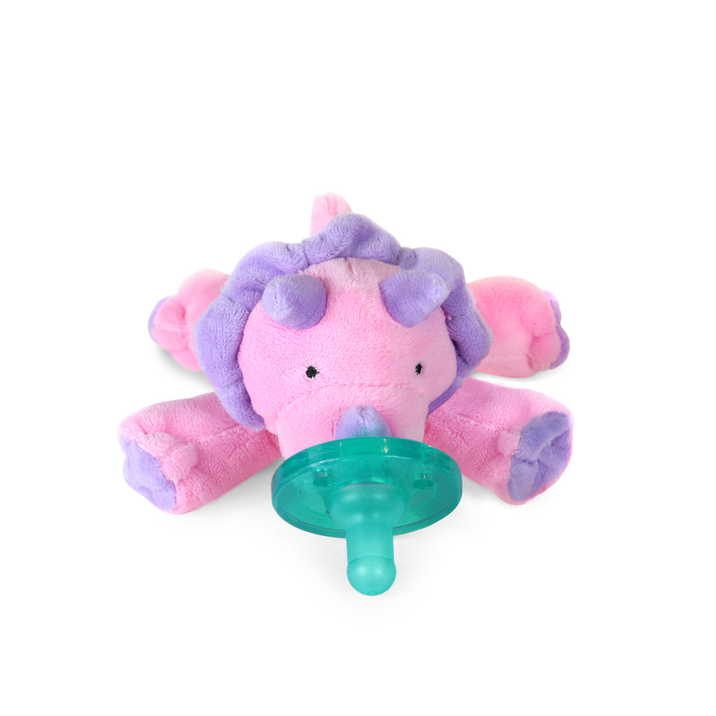 WubbaNub Chrissy the Dinosaur is pink with purple accents