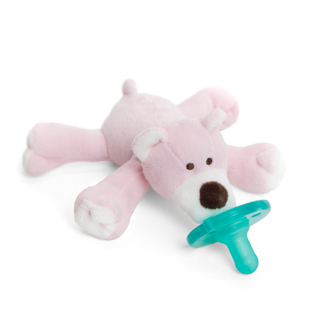WubbaNub Infant Plush Pacifier Pink Bear is soft pink fabric with white accents on paw pads, ears and face and a brown nose