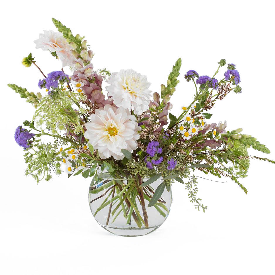 An English garden with seasonal flowers in a glass medallion.
