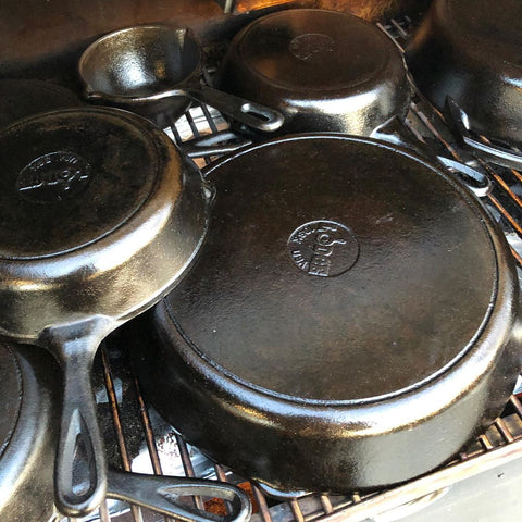Tim Shelburn's Lodge Cast Iron skillets with a non-stick seasoning from applying Crisbee Cast Iron Seasoning on the grill