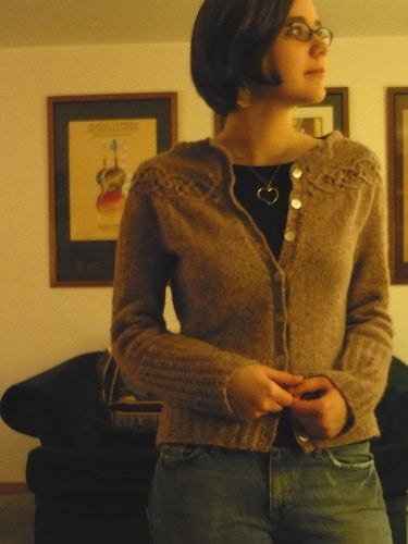 mary wears a hand knit wool cardigan
