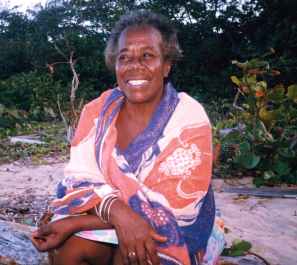 Teju's Jamaican Grandmother with a big smile and a beautiful fabric wrap.
