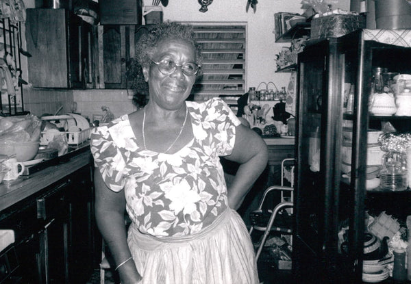 Teju's Jamaican Grandmother posing in her kitchen.