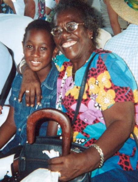 A young Teju with her Grandmother who has her arm lovingly draped over her shoulder.