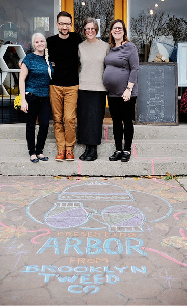Wool and Honey owners Liz Neddo and Melissa Kelenske stand with Jared Flood outside their shop celebrating the launch of Arbor wool yarn