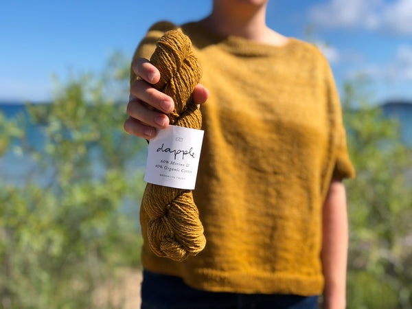 wool and organic cotton blend yarn Dapple with a hand knit Ginn sweater in the background