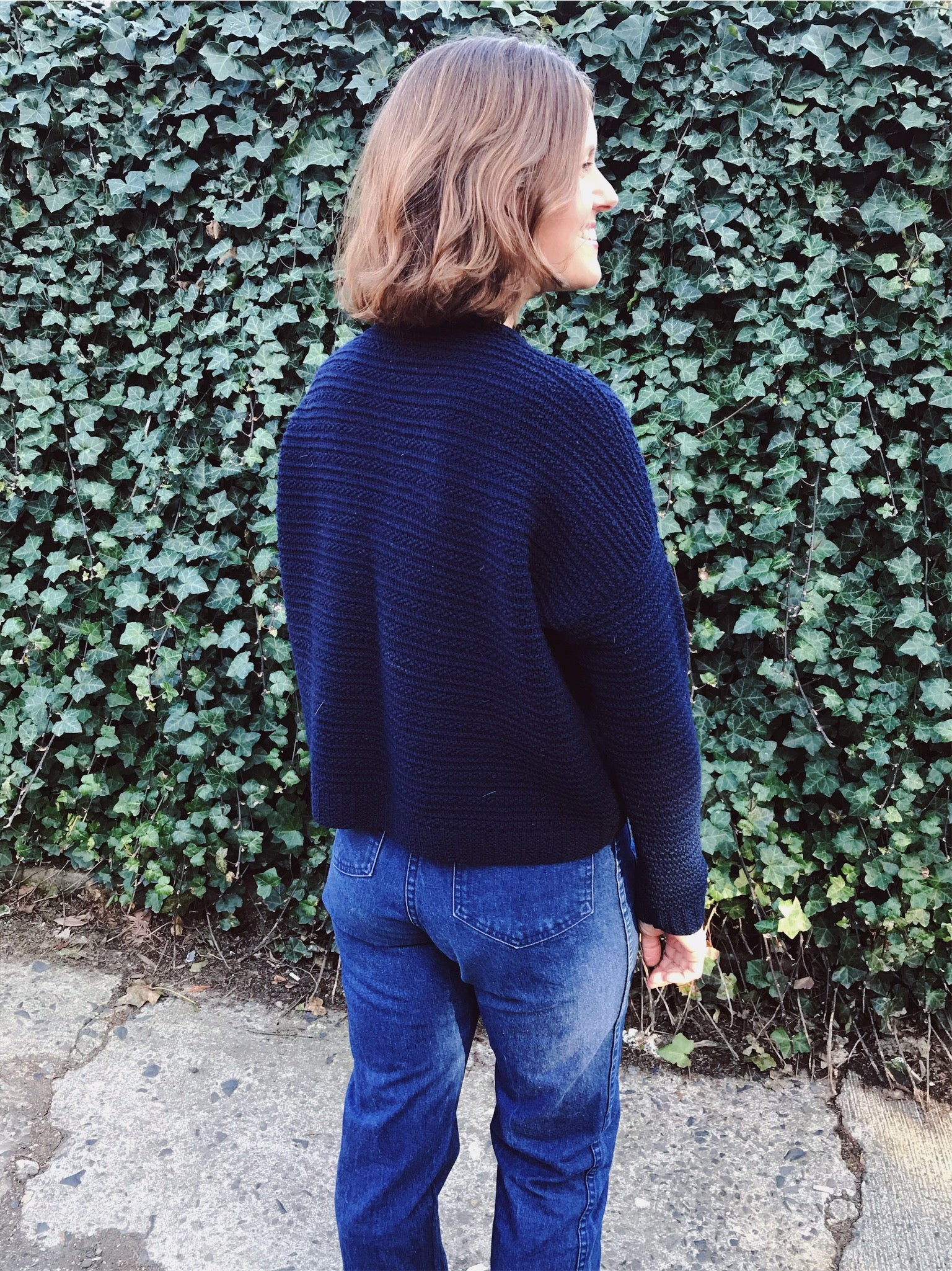 lis wears her hand knit wool weidlinger pullover sweater