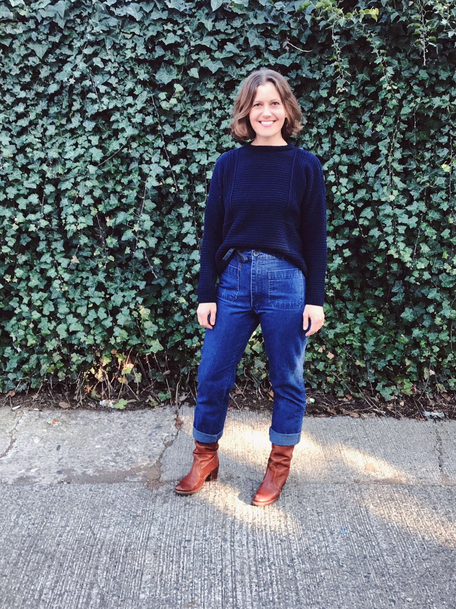 lis wearing her top down pull over weidlinger hand knit sweater