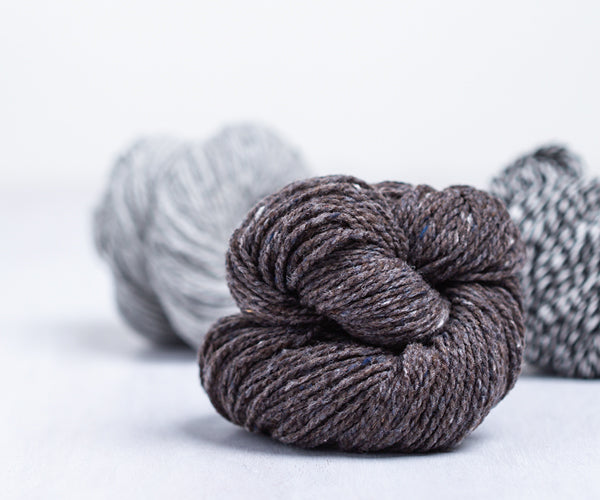 Brooklyn Tweed Shelter Yarn Skeins in Colors Truffle Hunt, Newsprint and Snowbound