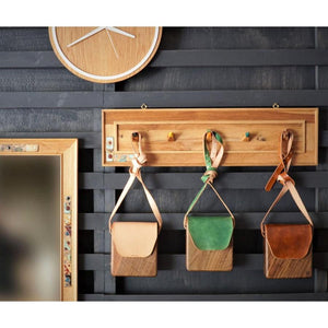 Wood coat rack with ceramics