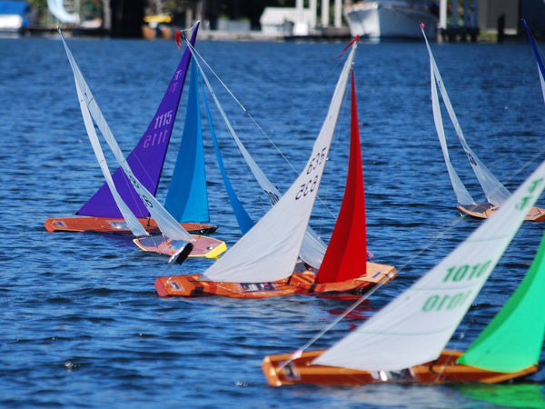 RC Sailboat Racing: A group of Model Sailboats at a Remote Control Boat Race