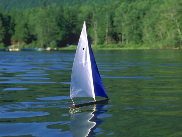 Wooden Toy Sailboat T15 Racing Sloop Sailing on a lake