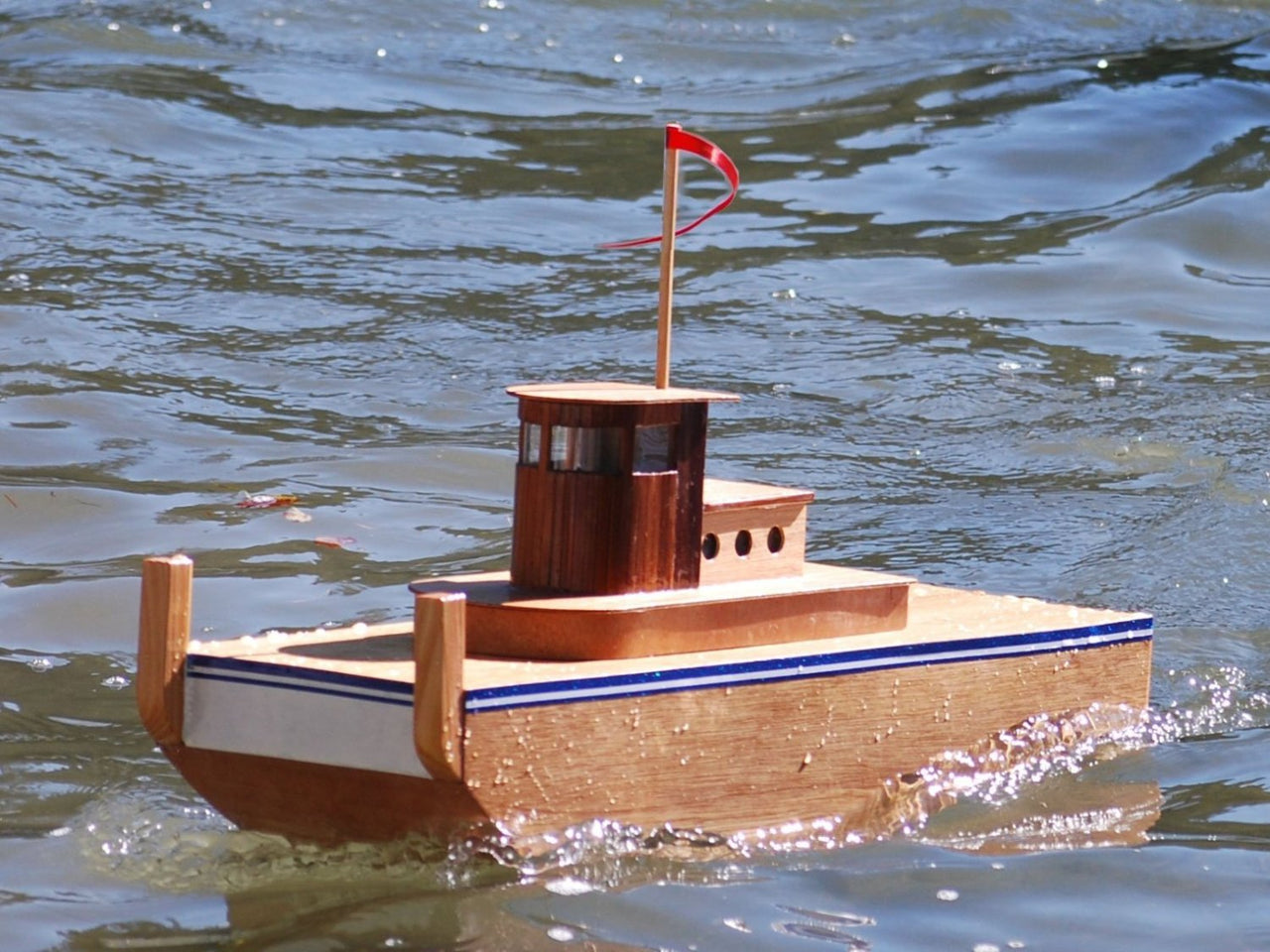 RC Tugboat: Remote Control Boat Speeding through the water