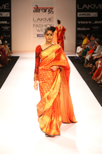 Adhesive Orange color Soft Silk Designer Saree